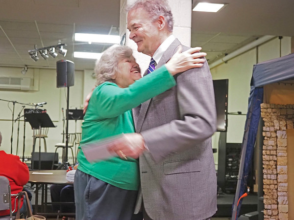 Elkhart Mayor Tim Neese recieves a thank you letter from Iris Dawson, of Elkhart, during the Elkhart County Council on Aging Christmas party at First Presbyterian Church in Elkhart Thursday.