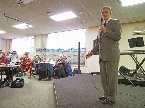 Elkhart Mayor Tim Neese speaks to the seniors attending the Elkhart County Council on Aging Christmas party at First Presbyterian Church in Elkhart Thursday.