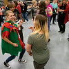 Joseph Weiser | The Goshen News<br /> Concord Student Council representative Alexis Brewton, 15, of Elkhart, daces with life skills students during the Concord Life Skills Christmas Party at Concord High School Tuesday. Students from the surrounding school districts including Goshen, NorthWood, Jimtown, and North Ridge attended the event.