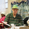 """Dave Stevens, of Elkhart, plays the """"Pass the Gift"""" game during the  Elkhart County Council on Aging Christmas party at First Presbyterian Church in Elkhart Thursday."""