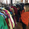 John Kline | The Goshen News<br /> Eliana Medrano, central registrar for Goshen Community Schools, browses a display of winter coats recently donated as part of the school corporation's annual community winter clothing give-away program.