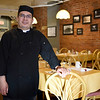 BEN MIKESELL | THE GOSHEN NEWS<br /> Felix Ramirez, owner of the new Felix New York Style Restaurant in the Old Bag Factory, stands in his restaurant Friday afternoon before starting the restaurant's first dinner shift. Ramirez opened his restaurant on Jan. 2.