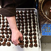 BEN MIKESELL   THE GOSHEN NEWS<br /> Nut Shoppe owner Danae Bell places cherry cordials on a tray after dipping them in chocolate Wednesday afternoon in her shop on Main Street in Goshen.