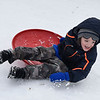 BEN MIKESELL | THE GOSHEN NEWS<br /> Alister Abramson, 5, of Syracuse, takes a spill while sledding down the hill Saturday afternoon at Abshire Park.