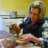 BEN MIKESELL | THE GOSHEN NEWS<br /> Ellen Hemminger, of Goshen, pours chocolate into a heart mold Thursday morning at Olympia Candy Kitchen in Goshen.