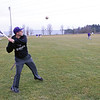 Roger Schneider | The Goshen News<br /> Goshen College baseball coach Alex Childers prepares to loft a fly ball to one of his players during the team's first outdoors practice Tuesday. The team has three games scheduled against Oakland City University near Evansville this weekend. According to Childers the playing of the games will depend on the weather.