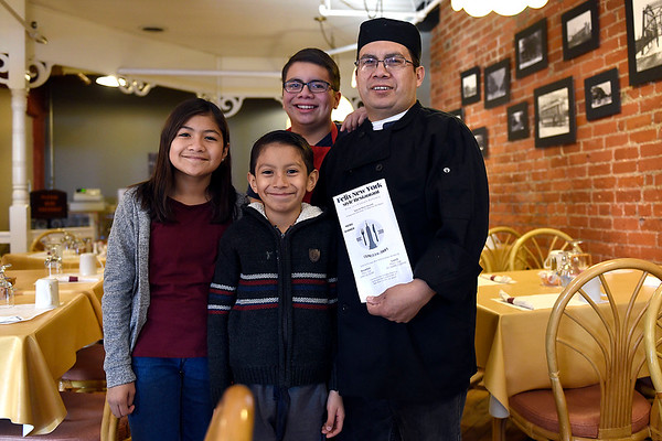 BEN MIKESELL | THE GOSHEN NEWS<br /> Felix Ramirez, owner of the new Felix New York Style Restaurant in the Old Bag Factory, stands with his two sons Daniel, 16, Josias, 9, and daughter Emily, 12, Friday afternoon before starting the restaurant's first dinner shift. Ramirez opened his restaurant on Jan. 2.