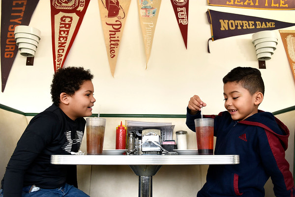BEN MIKESELL | THE GOSHEN NEWS Parkside Elementary first-graders Carter Houston, left, and Erick Pizana Hernandez, enjoy their glasses of phosphate soda they stirred themselves Thursday morning at the South Side Soda Shop in Goshen. Parkside students take a field trip across the street each year to learn about basic economics, such as supply and demand as well as goods and services.