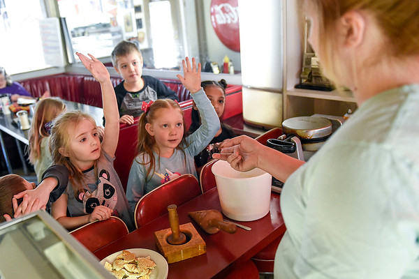 BEN MIKESELL | THE GOSHEN NEWS Parkside Elementary first-graders answer questions from employee Rain Harrison during a field trip to the South Side Soda Shop in Goshen.