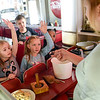 BEN MIKESELL | THE GOSHEN NEWS<br /> Parkside Elementary first-graders answer questions from employee Rain Harrison during a field trip to the South Side Soda Shop in Goshen.