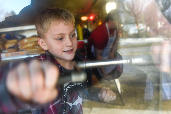 BEN MIKESELL | THE GOSHEN NEWS Parkside Elementary first-grader Magnus Eberly turns the crank to make curly fries during a field trip Thursday morning at the South Side Soda Shop in Goshen.