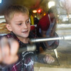 BEN MIKESELL | THE GOSHEN NEWS<br /> Parkside Elementary first-grader Magnus Eberly turns the crank to make curly fries during a field trip Thursday morning at the South Side Soda Shop in Goshen.