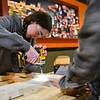 BEN MIKESELL | THE GOSHEN NEWS<br /> Eighth-grader Mia Towers, Granger, drills into a frame while making beds for the Michiana Pay it Forward Foundation Wednesday afternoon at the former Kaizen Hibachi Grill Sushi & Bar building at 2820 Elkhart Road in Goshen. The beds will be distributed by Sleep In Heavenly Peace, a non-profit organization in Elkhart County that provides beds for children and families in need.