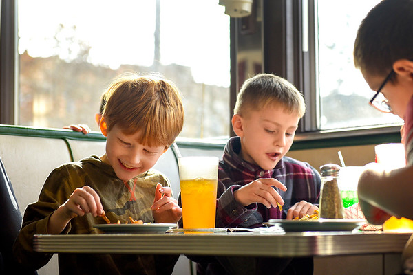 BEN MIKESELL | THE GOSHEN NEWS Parkside Elementary first-graders Christian Frazier, left, and Magnus Eberly, right, enjoy their curly fries and phosphate sodas they made on a field trip Thursday morning at the South Side Soda Shop.