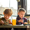 BEN MIKESELL | THE GOSHEN NEWS<br /> Parkside Elementary first-graders Christian Frazier, left, and Magnus Eberly, right, enjoy their curly fries and phosphate sodas they made on a field trip Thursday morning at the South Side Soda Shop.