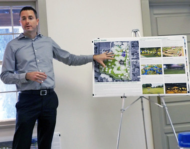 Denise Fedorow | The Goshen News Michael Reese of the Troyer Group shows one of the posters of the proposed plans for Nappanee  parks.