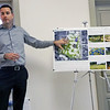 Denise Fedorow | The Goshen News<br /> Michael Reese of the Troyer Group shows one of the posters of the proposed plans for Nappanee  parks.