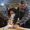 BEN MIKESELL | THE GOSHEN NEWS<br /> Tim Harmon, Goshen, right, helps eighth-grader Mia Towers, Granger, drill into a frame while making beds for the Michiana Pay it Forward Foundation Wednesday afternoon at the former Kaizen Hibachi Grill Sushi & Bar building at 2820 Elkhart Road in Goshen. The beds will be distributed by Sleep In Heavenly Peace, a non-profit organization in Elkhart County that provides beds for children and families in need.
