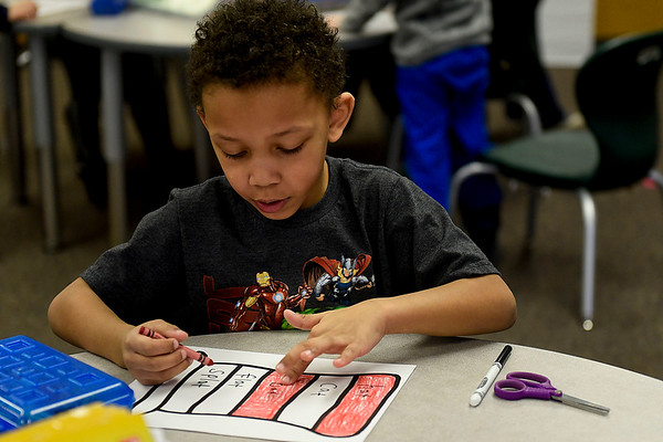 BEN MIKESELL | THE GOSHEN NEWS<br /> Kindergartener Malik Longs counts out the color pattern while making his Dr. Seuss-themed hat Wednesday morning at Concord East Side Elementary School.
