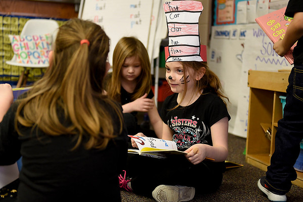 BEN MIKESELL | THE GOSHEN NEWS<br /> Kindergartener Jordyn Grant reads a Dr. Seuss book with classmates Wednesday morning at Concord East Side Elementary School to celebrate Dr. Seuss's birthday.