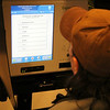 "SHEILA SELMAN | THE GOSHEN NEWS<br /> Robert Miller of Millersburg ""votes"" on one of the new ExpressVote voting machines purchased by Elkhart County Thursday night at the Goshen Public Library. Miller, who was using a wheelchair, liked the ADA-accessible features it offers. ""I love it. It's great,"" he said."