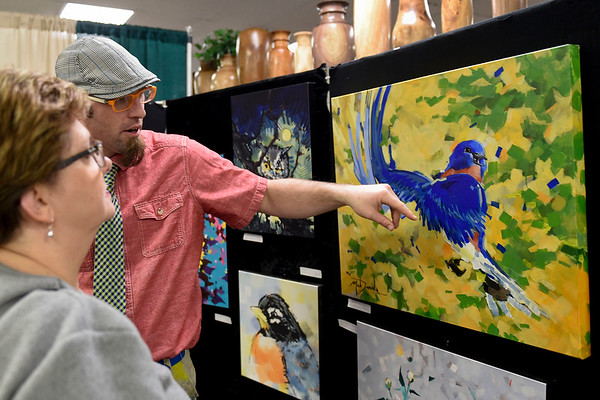 BEN MIKESELL | THE GOSHEN NEWS Goshen-based artist Mark Daniels shows off some of his work on display Saturday morning during the Elkhart County Garden Expo at the Elkhart County 4-H Fairgrounds.