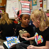 BEN MIKESELL | THE GOSHEN NEWS<br /> Kindergartener Saija Brown, left, reads a Dr. Seuss book with classmate Alixandra Waugh-Talbot Wednesday morning at Concord East Side Elementary School to celebrate Dr. Seuss's birthday.