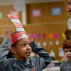 BEN MIKESELL | THE GOSHEN NEWS<br /> Kindergartener Malik Longs shows off his striped hat to his teacher, Jami Brouillette, during class Wednesday morning at Concord East Side Elementary School. This week Longs and his classmates celebrated the author's birthday, which is Saturday, by reading books including Cat in the Hat and Fox in Socks.