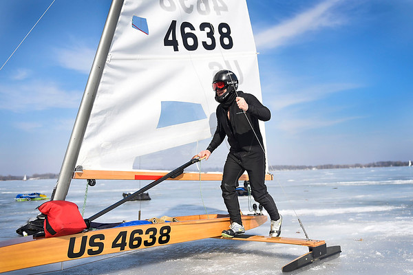 BEN MIKESELL | THE GOSHEN NEWS Guy Lovejoy, of Rochester, New York, brings his ice yacht into shore following the DN Ice Yacht North American Championship Friday afternoon at Lake Wawasee in Syracuse. Lovejoy was one of many racers from around the world to compete on the frozen lake as part of the International DN Ice Yacht Racing Association.