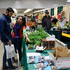 BEN MIKESELL | THE GOSHEN NEWS<br /> Poorna Bhagat, right, points out different plants for sale to Neel Bhagat, left, Saturday morning while walking through the Elkhart County Garden Expo at the Elkhart County 4-H Fairgrounds.