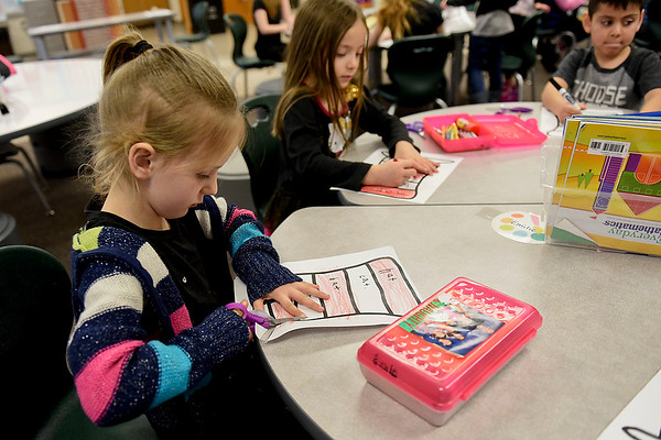 BEN MIKESELL | THE GOSHEN NEWS Kindergartener Emilie Braden cuts out striped hat during class Wednesday morning at Concord East Side Elementary School while celebrating Dr. Seuss's birthday.