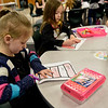 BEN MIKESELL | THE GOSHEN NEWS<br /> Kindergartener Emilie Braden cuts out striped hat during class Wednesday morning at Concord East Side Elementary School while celebrating Dr. Seuss's birthday.