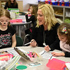 BEN MIKESELL | THE GOSHEN NEWS<br /> Kindergarten teacher Jami Brouillette, center, instructs Jordyn Grant, left, how to color her hat in class Wednesday morning at Concord East Side Elementary School.