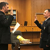 JOHN KLINE | THE GOSHEN NEWS<br /> Goshen Mayor Jeremy Stutsman, left, conducts the swearing-in ceremony for Ryan E. Ule following his promotion to the rank of private first class with the Goshen Fire Department during the Goshen Board of Public Works and Safety meeting Monday afternoon.