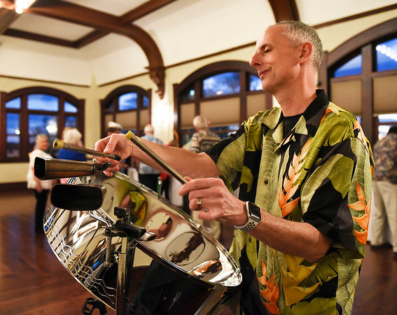 BEN MIKESELL | THE GOSHEN NEWS<br /> LaPorte musician Kent Arnsbarger plays music on a steel pan during the Goshen Rotary Club's 100-year celebration Friday night at the Spohn Ballroom in downtown Goshen. The party was Bahamian-themed to welcome the Rotary International president Barry Rassin of the Bahamas to the event to celebrate the 100th year of both the clubs from Goshen and Warsaw, which were started in 1919.