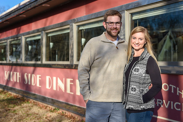 BEN MIKESELL | THE GOSHEN NEWS<br /> Barrett Younghans, Goshen, stands with his wife Chelsea outside the South Side Soda Shop in Goshen, where they frequently go to eat.