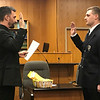 JOHN KLINE | THE GOSHEN NEWS<br /> Goshen Mayor Jeremy Stutsman, left, conducts the swearing-in ceremony for Colton C. Cox following his promotion to the rank of private first class with the Goshen Fire Department during the Goshen Board of Public Works and Safety meeting Monday afternoon.