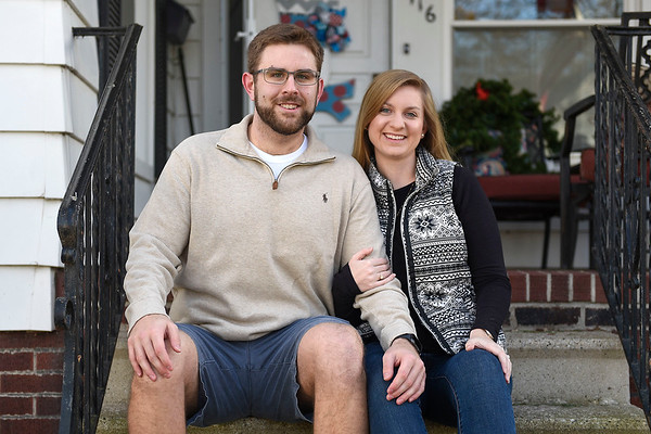 BEN MIKESELL | THE GOSHEN NEWS<br /> Barrett Younghans, Goshen, sits with his wife Chelsea outside his parents' house on Eighth Street in Goshen, where Barrett grew up and still lives while teaching at Goshen High School.