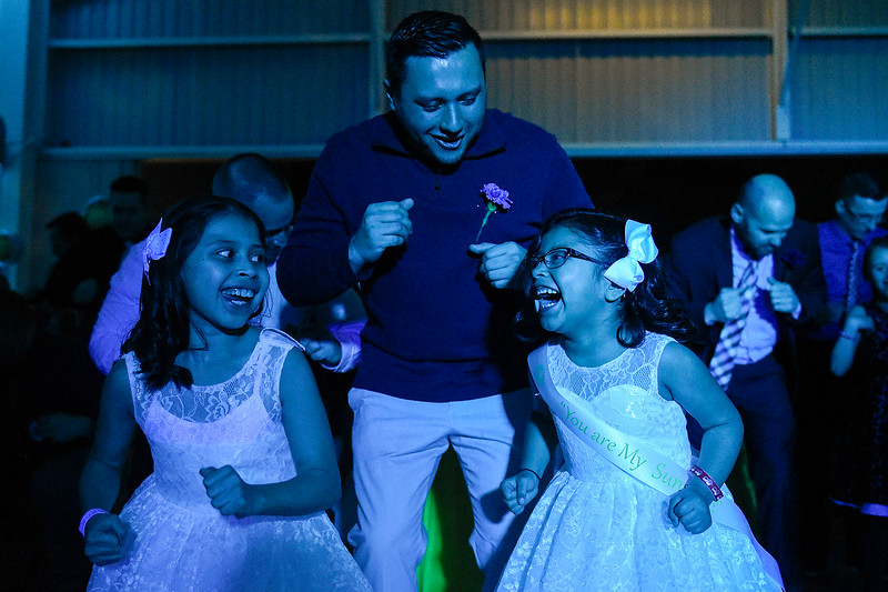BEN MIKESELL | THE GOSHEN NEWS Ricardo Ramirez, Goshen, does the chicken dance with his daughters Lexy, 8, left, and Madyson, 6, during the annual Daddy Daughter Dance Wednesday night at the Elkhart County 4-H Fairgrounds.