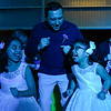 BEN MIKESELL | THE GOSHEN NEWS<br /> Ricardo Ramirez, Goshen, does the chicken dance with his daughters Lexy, 8, left, and Madyson, 6, during the annual Daddy Daughter Dance Wednesday night at the Elkhart County 4-H Fairgrounds.