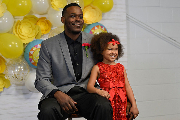 BEN MIKESELL | THE GOSHEN NEWS<br /> Cornelius Watkins, Goshen, gets a picture taken with his daughter Gabbi, 5, during the annual Daddy Daughter Dance Wednesday night at the Elkhart County 4-H Fairgrounds.