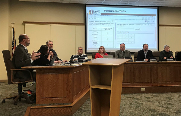 JOHN KLINE | THE GOSHEN NEWS<br /> Alan Metcalfe, assistant superintendent in charge of elementary education for Goshen Community Schools, left, talks with Goshen school board members Monday about the new ILEARN test, which is set to replace the state's ISTEP test later this spring.