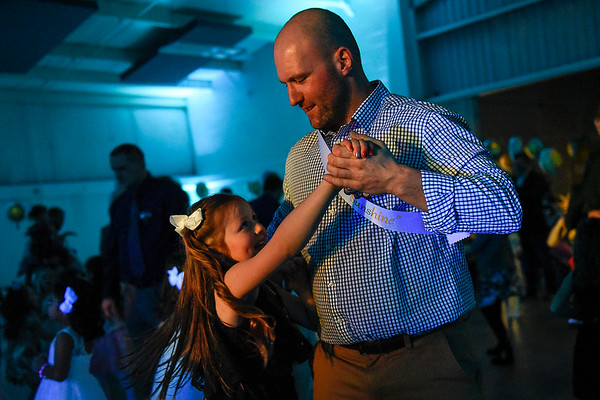 BEN MIKESELL | THE GOSHEN NEWS Anthony Harber, Goshen, dances with his daughter Alia, 7, during the annual Daddy Daughter Dance Wednesday night at the Elkhart County 4-H Fairgrounds.