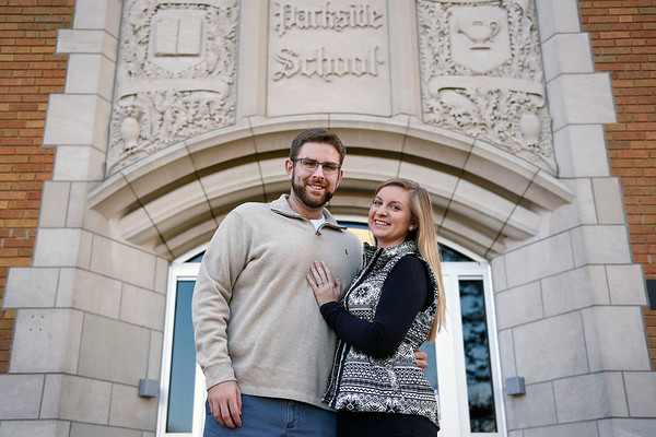 BEN MIKESELL | THE GOSHEN NEWS<br /> Barrett Younghans, Goshen, stands with his wife Chelsea outside of Parkside Elementary School where he attended grade school, just down the street from his parents' house.