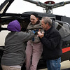 BEN MIKESELL | THE GOSHEN NEWS<br /> Bill Overhulser, 91, of Elkhart, is assisted out of a helicopter with the help of Greenleaf Living Center occupational therapist Sarah Hill, left, and his son Jim, right, Wednesday morning at the Goshen Municipal Airport. Overhulser had flown airplanes since the 1960s until he was no longer able to physically. His wife Phyllis and son Jim surprised the former aviator with the helicopter ride, courtesy of the Live a Dream program at Greenleaf Living Center, where Overhulser is a resident.