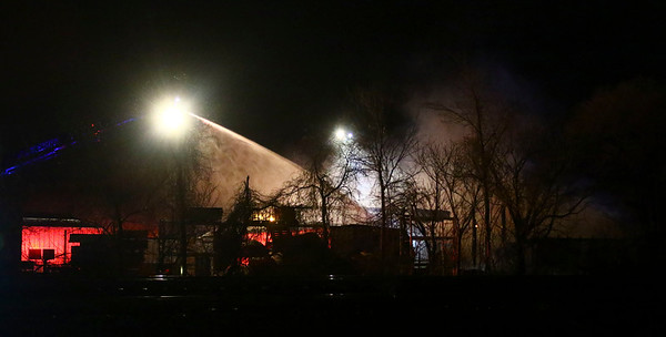 AUSTIN HOUGH | THE GOSHEN NEWS<br /> An aerial truck sprays water on top of the flames consuming Recycled/New Pallets Inc. in Dunlap Monday night.