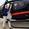 BEN MIKESELL | THE GOSHEN NEWS<br /> After the ride, airport manager Randy Sharkey exits the helicopter used to fly Bill Overhulser, 91, of Elkhart, seen in the window, Wednesday at Goshen Municipal Airport.