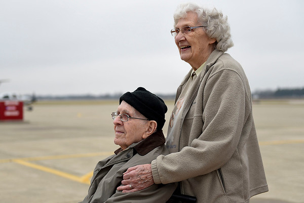 BEN MIKESELL | THE GOSHEN NEWS<br /> Bill Overhulser, 91, of Elkhart, waits with his wife Phyllis to ride in a helicopter Wednesday morning at the Goshen Municipal Airport. Phyllis and Overhulser's son Jim surprised the former aviator with the helicopter ride, courtesy of the Live a Dream program at Greenleaf Living Center, where Overhulser is a resident.