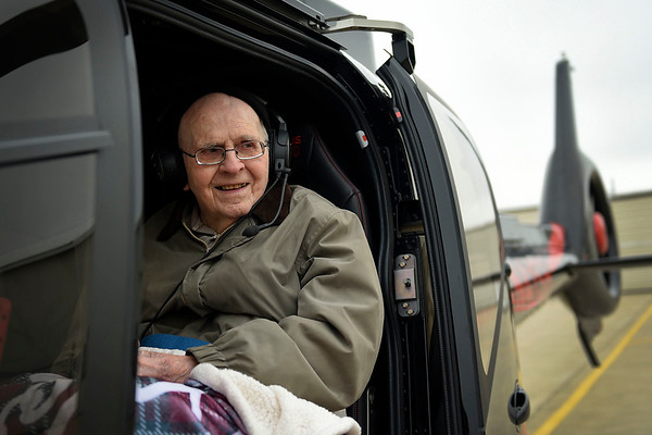 BEN MIKESELL | THE GOSHEN NEWS<br /> Bill Overhulser, 91, of Elkhart, smiles as he prepares to ride in a helicopter Wednesday morning at the Goshen Municipal Airport. He had flown airplanes since the 1960s until he was no longer able to physically. Overhulser's wife Phyllis and son Jim surprised the former aviator with the helicopter ride, courtesy of the Live a Dream program at Greenleaf Living Center, where Overhulser is a resident.