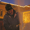 GEOFF LESAR | THE GOSHEN NEWS<br /> <br /> Danny Bloss II, of Niles, Michigan, carves an ice sleigh outside JoJo's Pretzels Friday evening during First Fridays Fire and Ice Festival in Goshen.